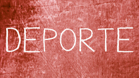 brownish: Deporte sport spanish capitals word on red background of chalkboard