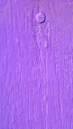 knothole: Violet wood vertical close up abstract background with one knothole circle Stock Photo