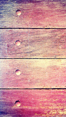 Old pink wood paint close up background Stock Photo