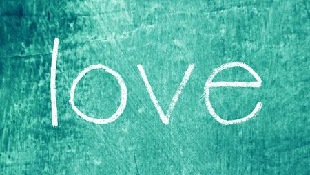 Love study on blue grungy background photo