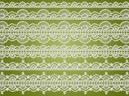 sophistication: White delicacy of crochet laces on green abstract xmas background Stock Photo