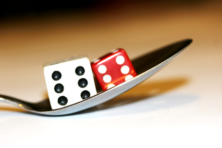Good luck side for food conceptual dices and spoon stock image photo