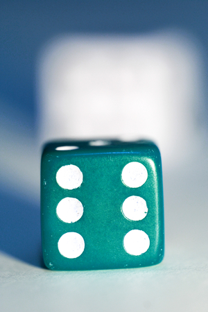Blue dice cube with six close up photo