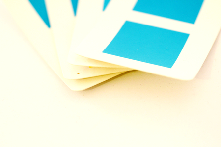 selector: Playing cards or color selector with blue squares close up on white Stock Photo
