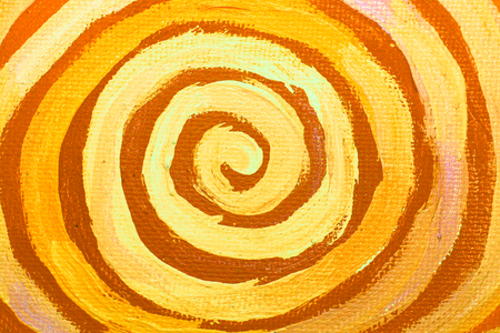 Naif yellow painted circle of spiral on canvas background photo