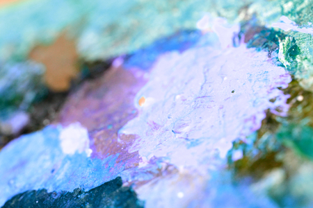 yellow  ochre: Blue paint colors on painter palette close up abstract background