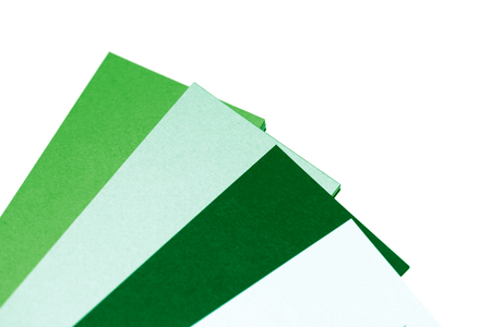 diagonals: Green tones paper palette close up isolated on white abstract background Stock Photo