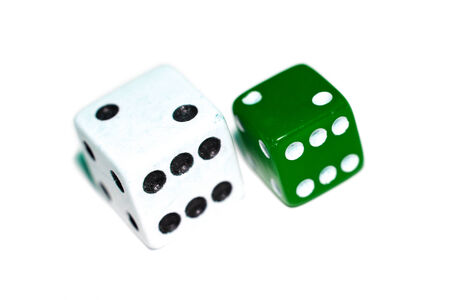 small articles: Green and white two isolated dices closeup Stock Photo