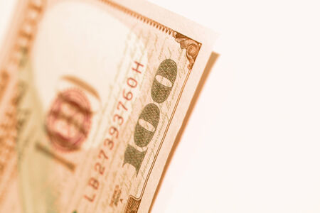 one hundred dollars: One hundred dollars bill closeup in sepia on white