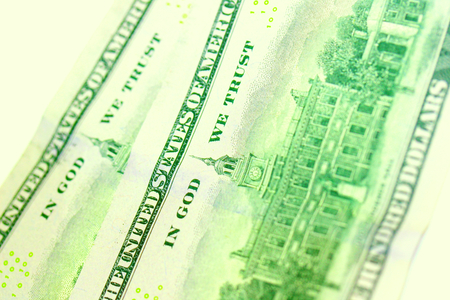 in god we trust: Green dollars bills closeup with text In God We Trust