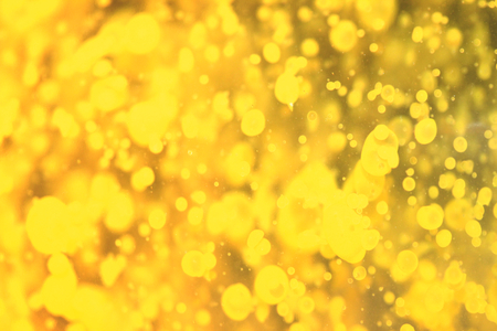 Yellow paint bubbles floating in water abstract background photo