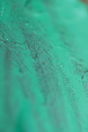 Emerald green paint blured abstract brushed background photo