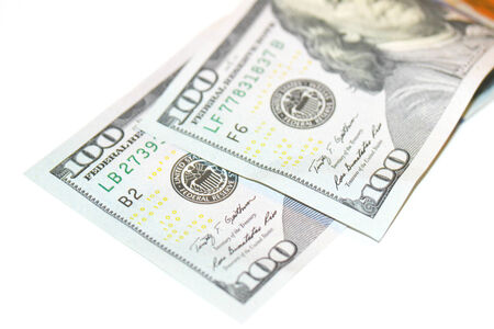 one hundred dollars: One hundred dollars bills couple isolated on white