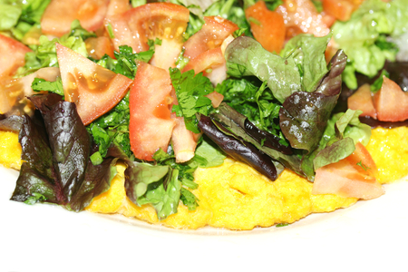 Tomato and crisp roman lettuce salad on flat bread isolated on white photo