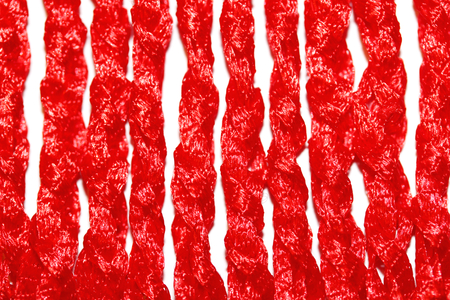 delicated: Red vertical lines of crochet knitted closeup abstract isolated on white Stock Photo