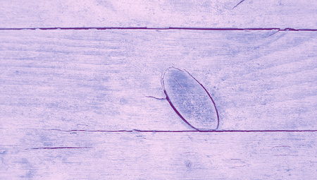 knothole: Wood closeup with a knothole background closeup with blue laquer paint