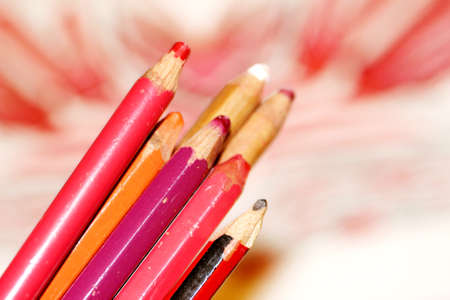 extreme close up: Pencils to draw with warm colors artistic closeup
