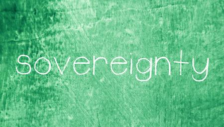 sovereignty: Sovereignty word on green school blackboard background Stock Photo