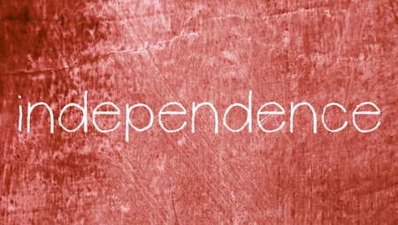 redish: Independence concept word on red vintage abstract grunge background