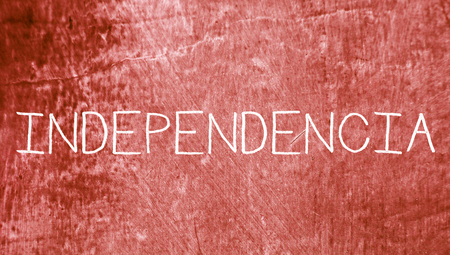 redish: Independence concept spanish word on red abstract grunge background