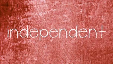 independent: Independent concept word on red abstract grunge background