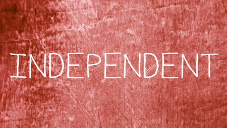 redish: Independent caps english word on grunge red background Stock Photo