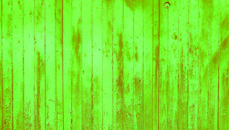 knothole: Wall of lemon green wood paint abstract background