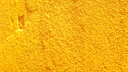 goldish: Yellow wall rustic wall closeup abstract background Stock Photo