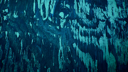 knothole: Dark blue painted wood cracked abstract background