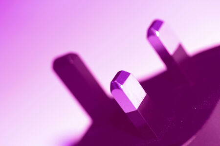 closeups: Electronic plug closeup on purple abstract background Stock Photo