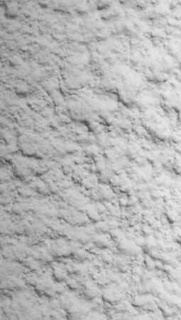 Gray wall texture with protuberances closeup abstract background
