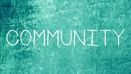 Community caps word of chalk on blue grunge background photo
