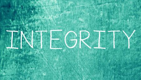 Integrity chlak caps word on grunge blue background photo