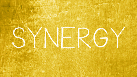 synergy: Synergy concept of chalk on grungy background
