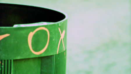trash container: Trash container closeup with graffiti Stock Photo