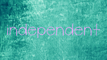 independent: Independent word on blue grungy chalk board background