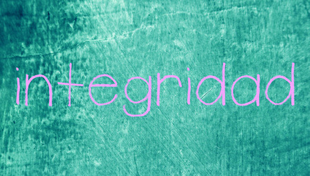 Integrity spanish class word on grunge blue background photo
