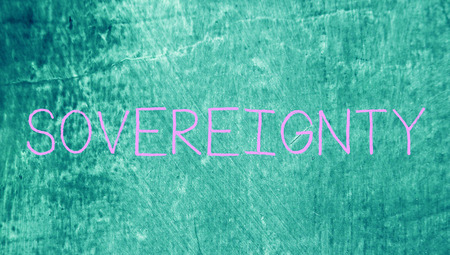sovereignty: Sovereignty handwritten word with chalk letters on grungy background