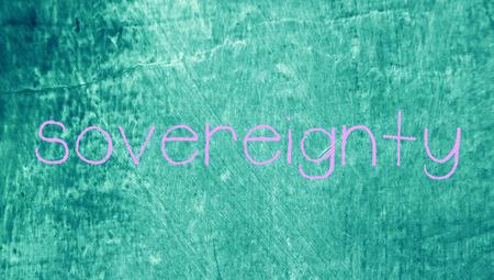 Sovereignty handwritten word on chalk grunge blue background photo