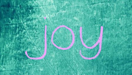 Joy concept on blue grunge background photo