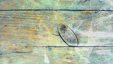 Old wood abstract background with big knothole closeup