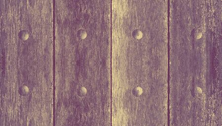 Wood door closeup abstract background with nails circles