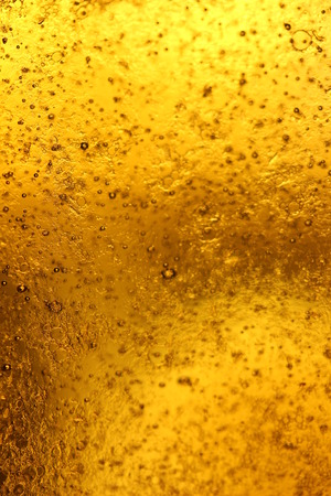 goldish: Golden abstract background of glass like beer with little bubbles