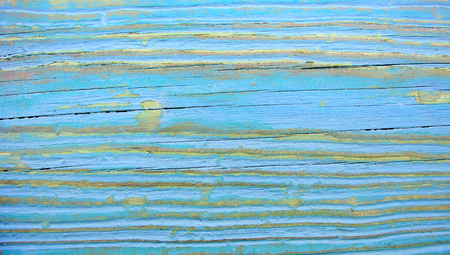 Old blue paint on stripes wood background photo
