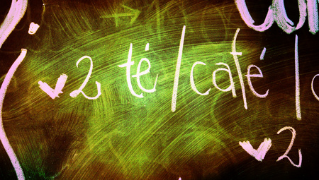 closeups: Tea and coffee blackboard background of green light