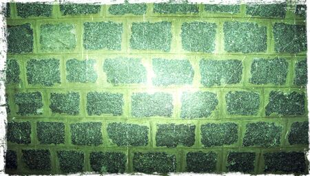 close ups: Stones wallGreen light on old stone wall background