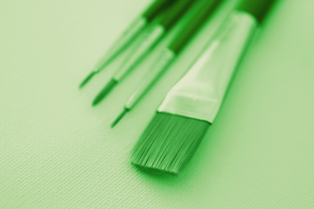 fine tip: Brushes for painting tools close up in green color stock image Stock Photo