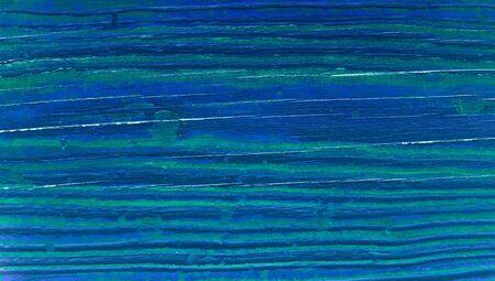 dark blue: Dark blue paint on striped wood background