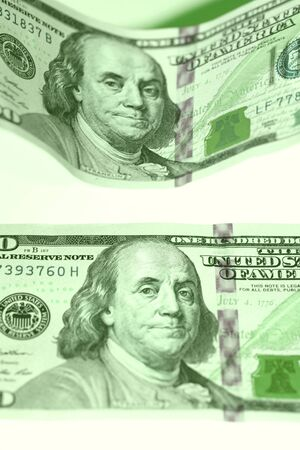 Green money papers of us dollars close up photo