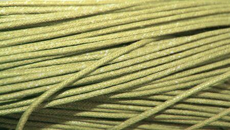 materia prima: Materia prima de hilo beige cerca de fondo fondo de pantalla Foto de archivo